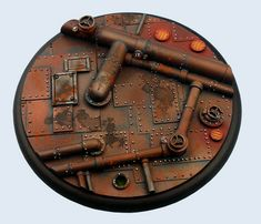Micro Art Studios have released a new selection of bases which are perfect for any miniature who finds itself in the industrial landscape of a steampunk world; the pipework bases. Wargaming Terrain, 40k Terrain, Warhammer 40k Figures, Warhammer 40000, Miniature Bases, Viking Helmet, Model Hobbies, Mini Paintings, Paint Schemes