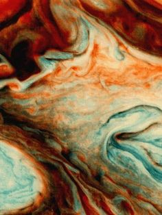 Exaggerated hues in this false-color image tint clouds swirling southeast of Jupiter's Great Red Spot.