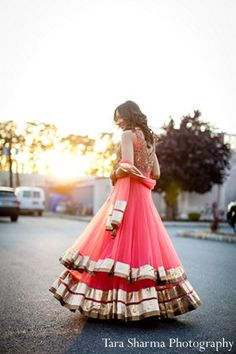 indian wedding bride sangeet lengha pink
