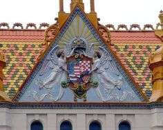Zsolnay porcelain Hungarian coat of arms of the Postal Palace facade - Pecs, Hungary