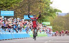 Stage 3 winner Team BMC's Ben Herrmans crosses the line at Roundhay Park in Leeds
