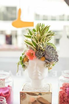 Succulents are great…but succulents as the hair on a ceramic head planter are outstanding. source.