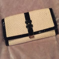 Cole Haan Clutch Cole Hann Clutch. Cream strawish like material with black patent leather. Button clasp. Lots of pockets. Great condition. make an offer everything in my closet is negotiable Cole Haan Bags Clutches & Wristlets