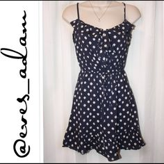 """Navy & White Polka Dot Linen Feel Dress This is a preloved dress that has a lot of life left in it. Made of a comfortable light linen material with adjustable spaghetti straps and a ruffle front upper. Has a drawstring waist. Approximately 31"""" no stains or tears. Navy dress with white polka dots. Fire Los Angeles Dresses"""