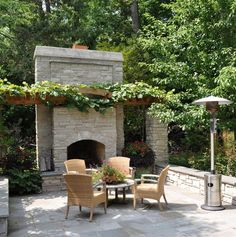 outdoor fireplace with arbor