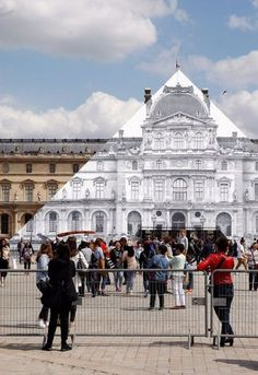 In Paris, Artist Makes Louvre Pyramid Disappear