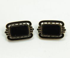 This is a striking pair of Victorian era mourning brooches. Worn to remember the loss of a loved one, the brooches are finely crafted in a graceful Classical revival style with gracefully curving frames in 14k yellow gold.   eBay!