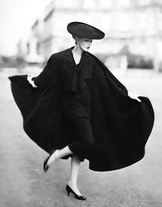 "Dovima in cape ensemble by Lanvin-Castillo, photo by Richard Avedon, Place Francois-Premier, Paris, August 1955    From the book: ""Avedon Photographs 1947-1977""Pub. Farrar, Strauss & Giroux 1978"