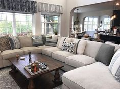 I have an obsession with pillows. #sorrynotsorry  Couch: @ashleyhomestore  Coffee table: @overstock  Pillows: @roseandremington  @worldmarket  Curtains: @macys Rug: @overstock