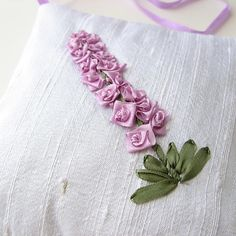 This lavender sachet features a stalk of silk ribbon flowers in a pretty lilac color hand-embroidered onto white silk dupioni fabric. The stem and leaves