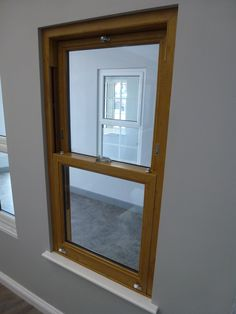 In our Tewkesbury branch, displaying our Oak Finished UPVC Vertical Sliding Sash. This is one of the most realistic oak finishes we've ever seen! Upvc Windows, Windows And Doors, Window Glazing, Window Styles, Sash, Entrance, Improve Yourself, Colours, Mirror