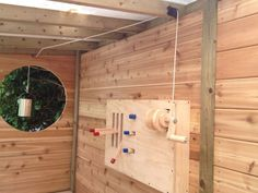 cranks and a dumbwaiter inside a tree fort on Gardenista
