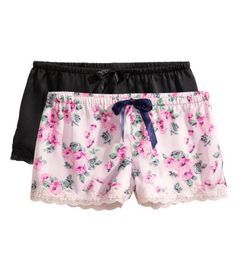 Pajama shorts in satin with lace trim at hems. Elasticized waistband with tie at front.