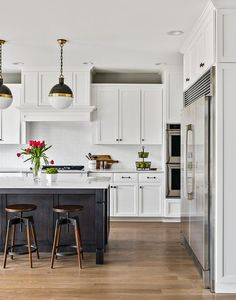 White Cabinets with Brown Oak Center Island