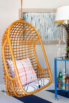 I want a hanging seat so badly! Love the tie dyed pink and white pillow as well!