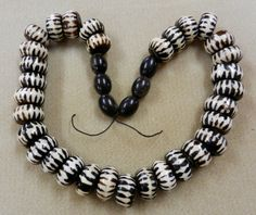 One Strand Of African Dark Brown, Black And White Batik Bone Beads With Black Water Buffalo Horn Beads On Black Waxed Cotton Cord