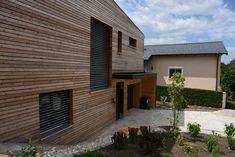 HAUS STL | AL Architekt Garage Doors, Outdoor Decor, Home Decor, Wood Facade, New Construction, Detached House, Decoration Home, Room Decor, Carriage Doors