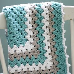 Give your baby a little taste of the ocean with the Sea Spray Granny Baby Blanket. With its cool blue shades, this granny square blanket is great for any little boy or girl!