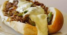 Awesome SLOW COOKER PHILLY CHEESE STEAK SANDWICHES