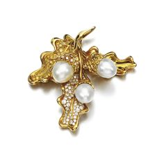 Cultured Pearl and diamond brooch, René Boivin, 1980s Designed as a spray of oak leaves and acorns, two leaves and cups pavé-set with brilliant-cut diamonds of various yellow and of near colourless tints, the acorns set with cultured pearls, signed René Boivin, French assay marks, fitted case stamped René Boivin.