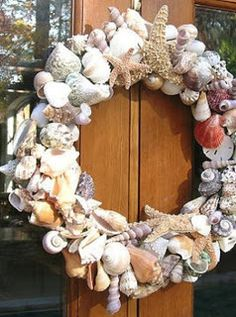 A very pretty wreath made from sea shells ,star fish, and sand dollars: