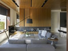 The designers have said that their goal was to create a space that was interesting even in the absence of decoration. In order to accomplish this, the materials used had to be captivating in and of themselves. Throughout the house you will see a lot natural wood, including walnut, as well as cool gray stone.