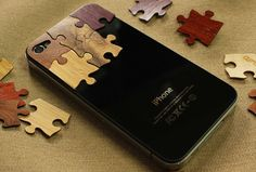 I don't have or want an iPhone... but i'll take those wooden puzzle pieces!