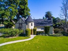 Located in the North Hills Historic District, this stunning Normandy-style home was designed by renowned architect Henry Jekel. The home known as The Harbor was built in 1931 for the Parker family who incorporated several nautical features throughout the home such as the small porthole shaped windows, elaborate sailing ship motif weathervane and shutters. The original signature Jekel leaded glass windows, solid wood doors with hammered knobs and decorative over-sized hinges, hardwood floors…