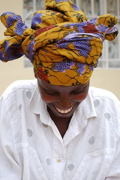 One of our partner artisans showing off a perfect color for March.   (see our Dutch wax collection: shop.indegoafrica.org)