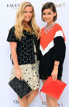 two stunning ladies show off their very well coordinated clutches