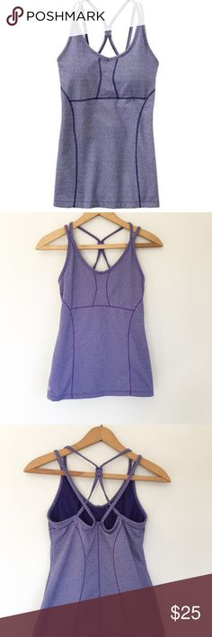 Athleta herringbone empowerment Tank Athleta Herringbone empowerment Tank in deep purple  Size small 43% Supplex Nylon / 22% Polyester / 18% Tactile Nylon / 17% Spandex A strappy back built in bra work out athletic tank. Hugs body for the perfect look while working out  Length- 23 in Pit to pit- 14.5 in or 29 in Athleta Tops Tank Tops
