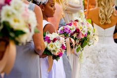 Lovely antique golden compotes held romantic garden blooms such as Juliet garden roses, lavender hydrangea, white clematis, and scabiosa flowers to name a few. Photos: True Photography. Wedding Coordinator Crown Weddings. Florals: Adorations Botanical Artistry.