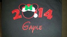 Mouse with Santa hat & bow and date with name on black tshirt.