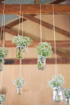 Mason Jar wedding ideas, Mason Jars with Gypsophila Tied from Beams with String