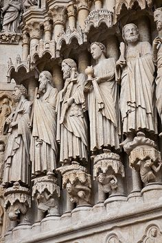 exterior sculpture work surrounding the main portal - Amiens Cathedral, France - built 1220-70 - the statues were originally polychromic and  appeared more true to life
