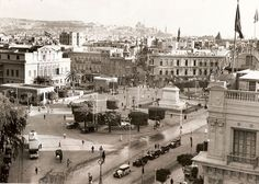 Opera Square, Cairo, probably in the 1930's, The opera building is on the left. It was destroyed by a fire in 1971. On the right was the Intercontinental hotel. This square was one of Cairo's central squares.