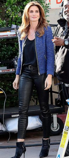 Cindy Crawford in J Brand leather leggings, booties and a blue jacket
