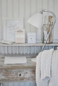 Love the white-washed wood desk. White offices--the calm white, not the sterile white--totally get me.