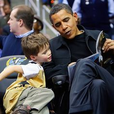 President Barack Obama reading to little boy.