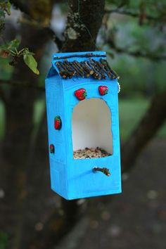 Bird Feeder made from a milk carton and twigs (just seal with an outdoor-rated sealant), via ChicSteals