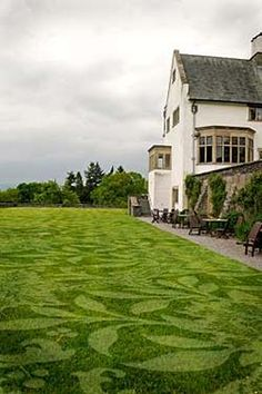 Lawnpaper traces William Morris wallpaper designs on lawns of Blackwell in Cumbria
