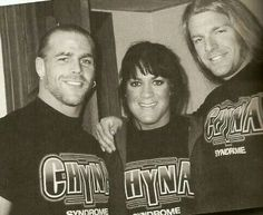 Shawn Michaels, Chyna, and Triple H.