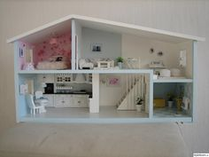 Fantastic doll house renovation, mosaic mirror in hallway is a perfect touch to complete it