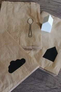 silhouette illustrations on brown paper bags  as wrappings