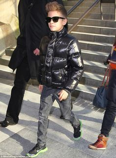 Cool dude: Romeo Beckham shows off his style as he stepped out in Paris on Tuesday