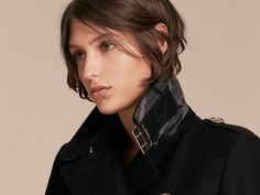 A Burberry military coat in a sumptuous wool-cashmere blend with domed buttons and distinctive buckled throat latch and cuffs.