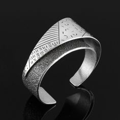 Cuff | Michael Roanhorse (Navajo). 'Floating angle'. Sterling silver
