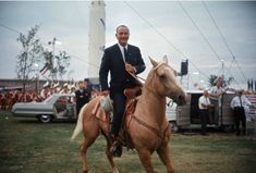 Lyndon B Johnson--Riding in a suit-Why not? With his Texas drawl, boots and bolo tie, LBJ always seemed much more suited to life on the ranch than life in Washington. Presidents Wives, Dead Presidents, Lyndon B Johnson, Pictures With Horses, Cult Of Personality, Year Of The Horse, Texas History, American Revolution, The Ranch