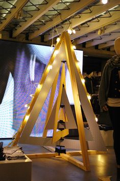 Up-cycled geometric shaped tree fixturing at Levis while Moschio opted for a traditional tree with all the product trimmings. Christmas Stage Design, Christmas Window Display, Cool Christmas Trees, Holiday Tree, Modern Christmas, Xmas Tree, Christmas Diy, New Years Decorations, Outdoor Christmas Decorations