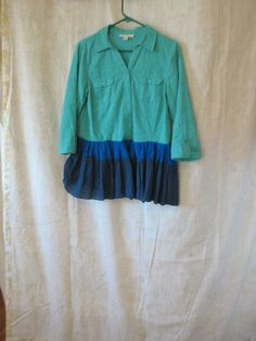 Turquoise, blue and navy tunic top, ruffles and romantic. 100% cotton. Jewel tone colors.   A button down blouse with 2 breast pockets, I added